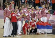 Members of the Russia men's basketball display their bronze medal following a ceremony at the 2012 Summer Olympics, Sunday, Aug. 12, 2012, in London. (AP Photo/Darron Cummings)