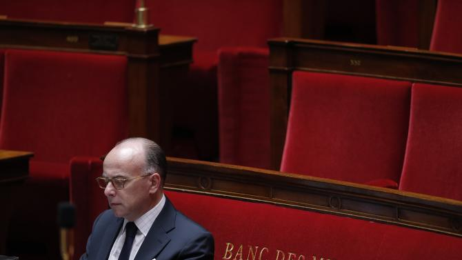 French Interior Minister Cazeneuve attends the questions to the government session at the National Assembly in Paris