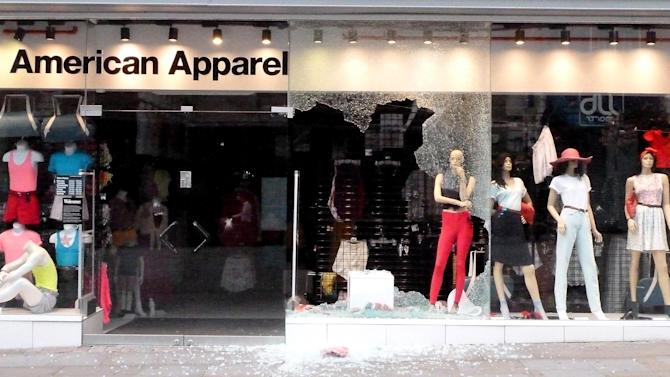 American Apparel shows signs of damage on Market street  in Manchester city centre, England,  Tuesday Aug. 9, 2011.  Britain began flooding London's streets with 16,000 police officers Tuesday, nearly tripling their presence as the nation feared its worst rioting in a generation would stretch into a fourth night. The violence has turned buildings into burnt out carcasses, triggered massive looting and spread to other U.K. cities.   (AP Photo /  Dave Thompson / PA)  UNITED KINGDOM OUT