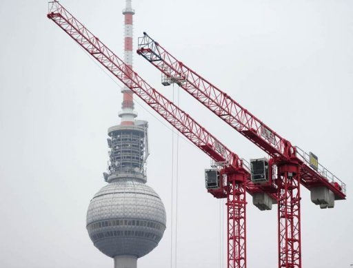 <p>Cranes pictured building site operate near Berlin's landmark TV tower November 2010. German industrial output increased in May, propelled by a sharp increase in activity in the construction sector, official data showed on Friday.</p>