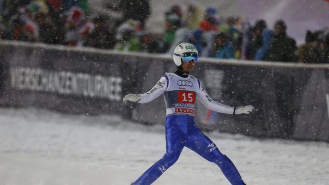 Ito from Japan reacts during the first round for the first jumping of the 63rd four-hills ski jumping tournament in Oberstdorf