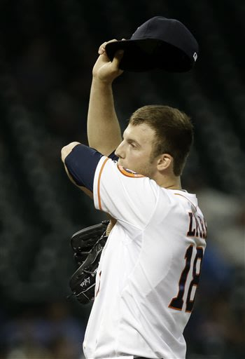 Houston Astros starting pitcher Jordan Lyles wipes his face after walking Kansas City Royals' Alex Gordon in the third inning of a baseball game on Wednesday, May 22, 2013, in Houston