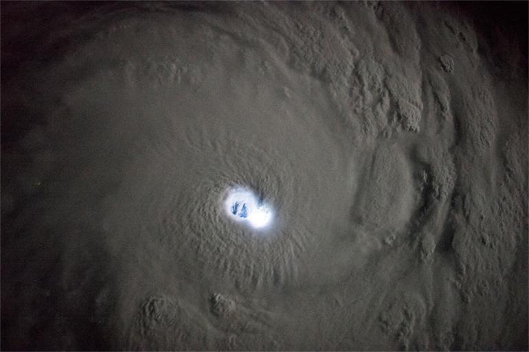 The electric eye of a cyclone, viewed from space