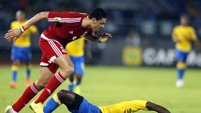 Raul lvan of Equatorial Guinea fights for the ball with Gabon's Bruno Ecuele during their Group A soccer match at the African Cup of Nations in Bata