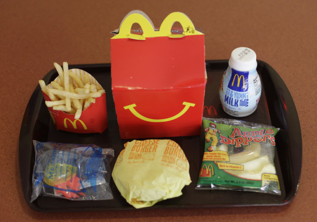 FILE - This Nov. 8, 2010 file photo shows a Happy Meal at a McDonald&#39;s restaurant in San Francisco, Ca. McDonald&#39;s, Burger King, Kentucky Fried Chicken and other fast-food companies are being sued in Chile for violating the country&#39;s new law against including toys with children&#39;s meals. The law took effect in July 2012 and its author, Sen. Guido Gerardi, filed suit Wednesday, Aug. 1, 2012, accusing the companies of knowingly endangering the health of children by marketing kids&#39; meals with toys. (AP Photo/Eric Risberg, File)