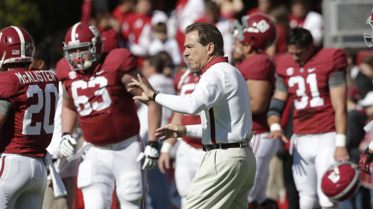 Alabama coach Nick Saban watches his team warm up prior to an NCAA college football game against Western Carolina at Bryant-Denny Stadium in Tuscaloosa, Ala., Saturday, Nov. 17, 2012. (AP Photo/Dave Martin)