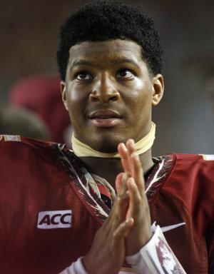 ADD UPDATES ABOUT NO CHARGES FILED - FILE - In this Sept. 21, 2013, file photo, Florida State quarterback Jameis Winston watches from the sidelines during the second half of an NCAA college football game against Bethune-Cookman in Tallahassee, Fla. Search warrants, released Thursday, Dec. 5, 2013, in the sexual assault investigation of Winston indicate the woman told police she was raped at an apartment after a night of drinking at a bar. State Attorney Willie Meggs said there was not enough evidence to pursue charges in the sex assault case against Winston. (AP Photo/Phil Sears, File)