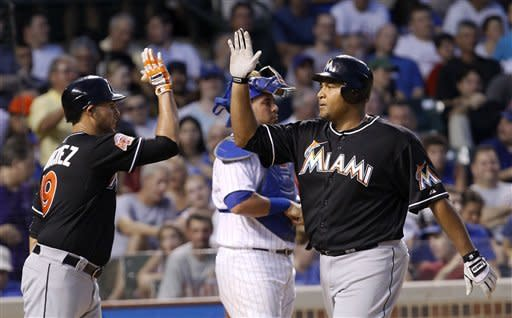 Lee hits grand slam, Marlins beat Cubs 9-5