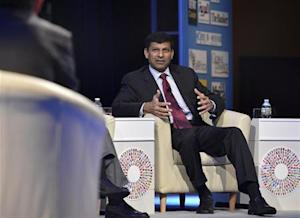 Reserve Bank of India Gov. Rajan answers question during CNN Debate on Global Economy part of IMF and World Bank's 2013 Annual Fall Meetings, in Washington