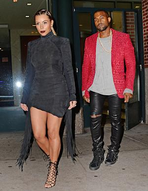 Kim Kardashian Wear Curve-Hugging, Short Black Dress With Large Tassels While Out With Kanye West