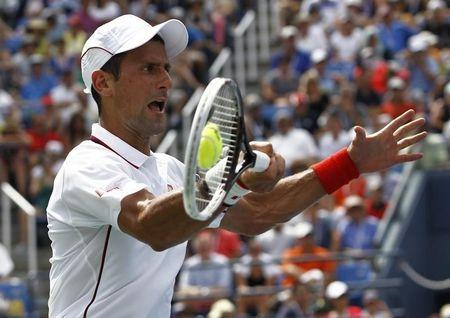 Novak Djokovic of Serbia hits a return during his match against Philipp Kohlschreiber of Germany during their match at the 2014 U.S. Open tennis tournament in New York
