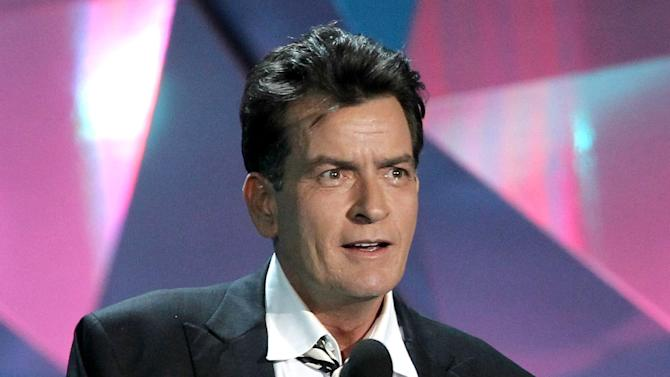 """FILE - This June 3, 2012 file photo shows actor Charlie Sheen at the MTV Movie Awards in Los Angeles. In an interview Tuesday, July 17, on Ryan Seacrest's radio show, Sheen said """"American Idol"""" producer Nigel Lythgoe publicly threw his name out there as a possible judge and the idea peaked his interest. Sheen told Jay Leno Monday night on """"The Tonight Show"""" that his two demands would be that FX and his """"Anger Management"""" team """"would have to be into it"""" and there would need to be a charitable component to him taking the job. (Photo by Matt Sayles/Invision/AP, file)"""