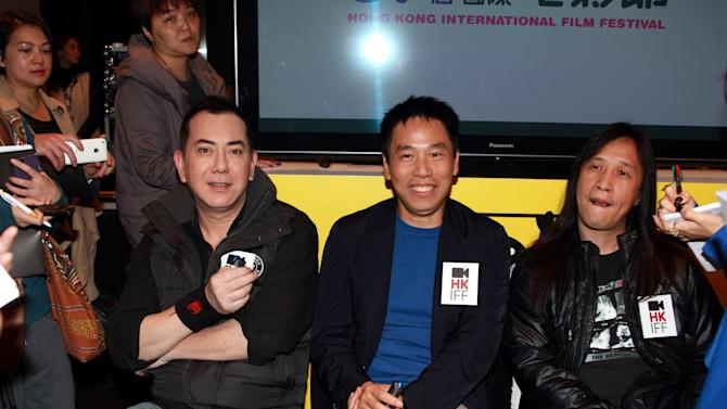"In this Feb. 21, 2013 photo released by China's Xinhua News Agency, from right to left: director of opening film ""Ip Man: The Final Fight"" Herman Yau Lai-To, producer Xian Guo-lin, actor Anthony Wong attend a press conference of the 37th Hong Kong International Film Festival in Hong Kong.  ""Ip Man: The Final Fight,"" about the latter years of the Wing Chun master Ip Man, will open the Hong Kong International Film Festival that starts March 17. (AP Photo/Xinhua, Jin Yi) NO SALES"