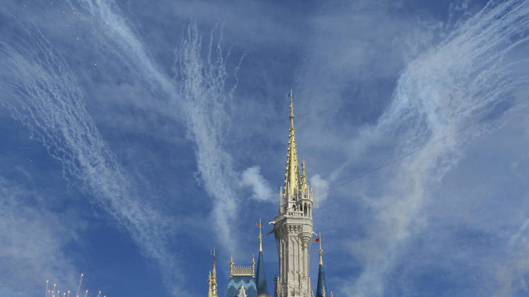 Fireworks punctuate the grand opening celebration at the Cinderella Castle for the New Fantasyland attraction at the Walt Disney World Resort's Magic Kingdom theme park in Lake Buena Vista, Fla., Thursday, Dec. 6, 2012. The new attraction is the largest expansion at the Magic Kingdom. (AP Photo/Phelan M. Ebenhack)
