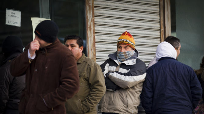 People queue outside an unemployment registry office in Madrid on Thursday, Dec. 2, 2010. The number of people filing claims for unemployment benefits rose for a fourth consecutive month in November by 24,318 for a rounded total of 4.1 million people receiving payments. (AP Photo/Victor R. Caivano)