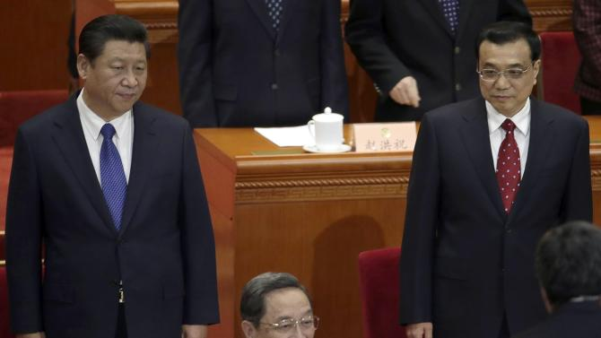 China's President Xi, Premier Li and Yu, chairman of the National Committee of the CPPCC, stand during the opening session of CPPCC at the Great Hall of the People in Beijing