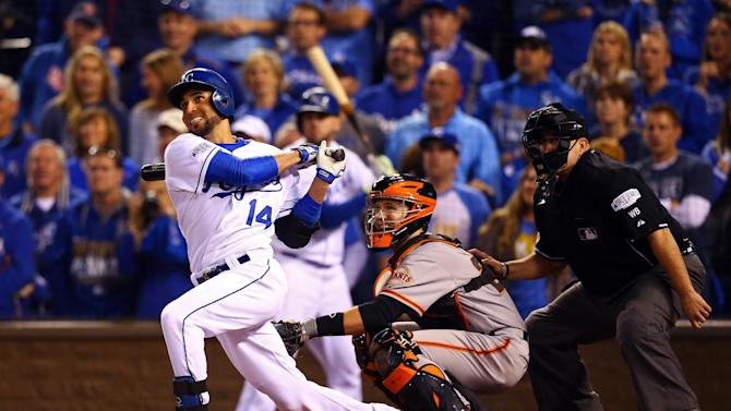 Omar Infante of the Kansas City Royals hits a two-run home run in the sixth inning against San Francisco Giants during Game Two of the 2014 World Series at Kauffman Stadium on October 22