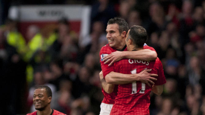 Manchester United's Robin van Persie, background right, celebrates with teammate Ryan Giggs after scoring his second goal against Aston Villa, during their English Premier League soccer match at Old Trafford Stadium, Manchester, England, Monday, April 22, 2013. (AP Photo/Jon Super)