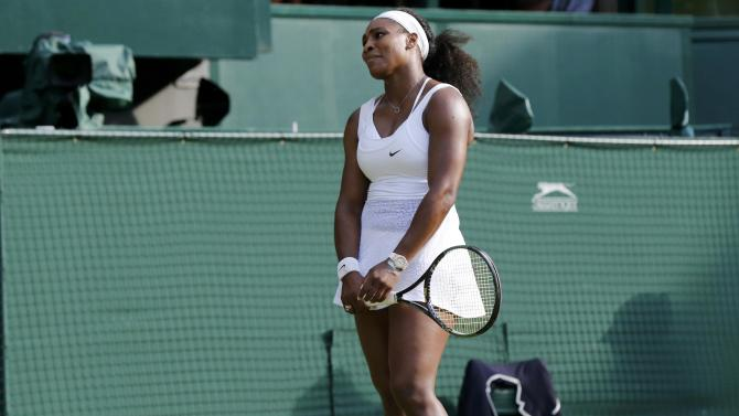 Serena Williams of the U.S.A. reacts during her match against Heather Watson of Britain at the Wimbledon Tennis Championships in London