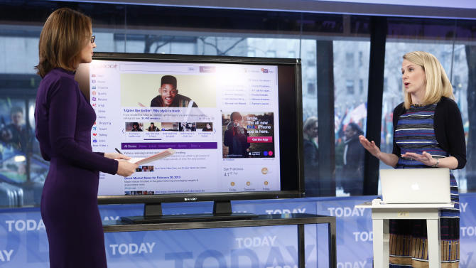 """This image released by NBC shows host Savannah Guthrie, left, with Yahoo CEO Marissa Mayer on NBC News' """"Today"""" show, Wednesday, Feb. 20, 2013 in New York as Mayer introduces the website's redesign. Yahoo is renovating the main entry into its website in an effort to get people to visit more frequently and linger for longer periods of time. The long-awaited makeover of Yahoo.com's home page is the most notable change to the website since the Internet company hired Marissa Mayer as its CEO seven months ago. The new look will start to gradually roll out in the U.S early Wednesday. (AP Photo/NBC Peter Kramer/NBC/NBC NewsWire)"""