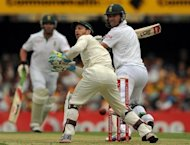 South African batsman AB de Villiers (R) plays the ball past Australian wicketkeeper Matthew Wade (C) during day three of the first cricket Test between South Africa and Australia at the Gabba ground in Brisbane