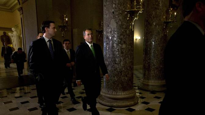 "Speaker of the House John Boehner, R-Ohio, center, returns to his office from the House chamber, as talks continue regarding the ""fiscal cliff"" bill passed by the Senate Monday night, on Tuesday, Jan. 1, 2013 at the Capitol in Washington. (AP Photo/Jacquelyn Martin)"