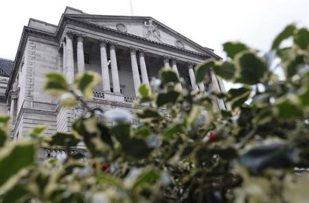 The Bank of England is seen behind holly bushes in the City of London