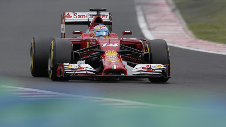 Ferrari driver Fernando Alonso of Spain =s1= during the qualifying of the Hungarian Formula One Grand Prix in Budapest, Hungary, Saturday, July 26, 2014. The Hungarian Grand Prix will be held on Sunday, July 27, 2014. (AP Photo/Petr David Josek)