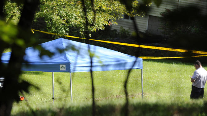 A blue tent protects the scene of a fatal shooting in New Fairfield, Conn., Thursday, Sept, 27, 2012. Police say Jeffrey Giuliano shot a masked teenager in self-defense during what appeared to be an attempted burglary early Thursday morning, then discovered that he had killed his son, Tyler. (AP Photo/The News-Times, Carol Kaliff)  MANDATORY CREDIT