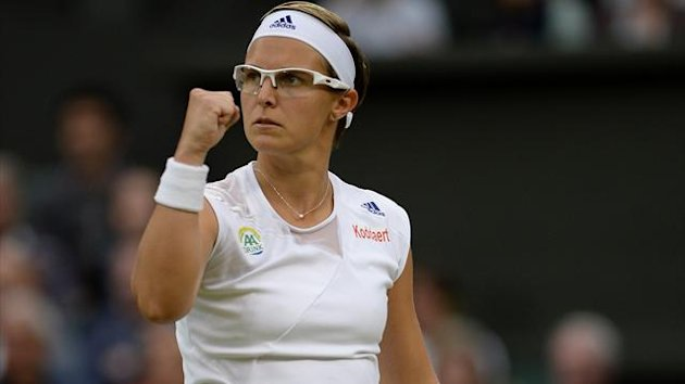 Belgium's Kirsten Flipkens celebrates match point as she defeats Czech Republic's Petra Kvitova (PA Sport)