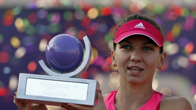 Halep of Romania holds the trophy of BRD Bucharest Open international tennis tournament after defeating Vinci of Italy in their women's singles final match in Bucharest