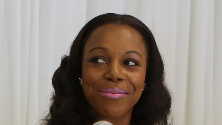 Jamaica's Olympic athletics medallist, Veronica Campbell-Brown, smiles during a news conference in Kingston