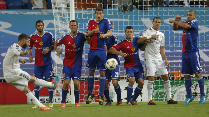 Real's Sergio Ramos kicks the ball during the Champions League Group B soccer match between Real Madrid and Basel at the Santiago Bernabeu stadium in Madrid, Spain, Tuesday, Sept. 16, 2014. (AP Photo/Andres Kudacki)