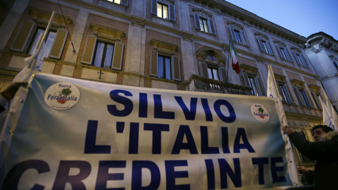 "Supporters of former Italian premier Silvio Berlusconi expose a banner reading ""Silvio Italy trusts you"" in front of Palazzo Grazioli, the residence of Berlusconi, in Rome, Thurdsday, Dec. 6, 2012. The 76-year-old Berlusconi has been hinting at a comeback, after earlier saying he would leave the party to a younger candidate. Berlusconi claims allies are pressing him to return, hoping that Monti's painful austerity measures will win votes for the center-right. Lawmakers belonging to Silvio Berlusconi's center-right party abstained Thursday from a confidence vote in the government of Premier Mario Monti, raising questions over its future and the progress of its economic reform program. (AP Photo/Alberto Pellaschiar)"