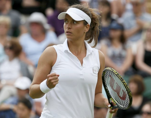 Petra Cetkovska of the Czech Republic reacts during her women's singles tennis match against Caroline Wozniacki of Denmark at the Wimbledon Tennis Championships, in London