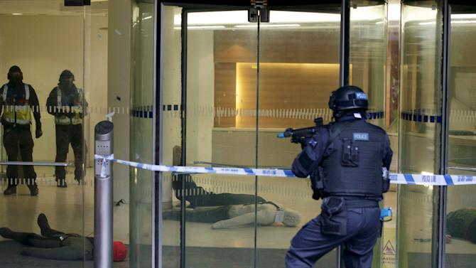 ARV officers participate in a police exercise simulating a millitant attack on a shopping centre during a Metropolitan Police training program for armed officers in London