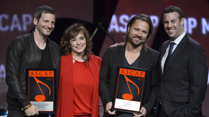 """Dr Luke  ASCAP Pop song award recipient for """"Good Feeling"""",  ASCAP's  Loretta Munoz, Songwriter of the Year Award recipient Max Martin and ASCAP's Jason Silberman are seen onstage at the 30th Annual ASCAP Pop Music Awards, on Wednesday, April 16, 2013, at Loews Hollywood Hotel in Hollywood, California. (Photo by Phil McCarten/Invision for ASCAP/AP Images)"""