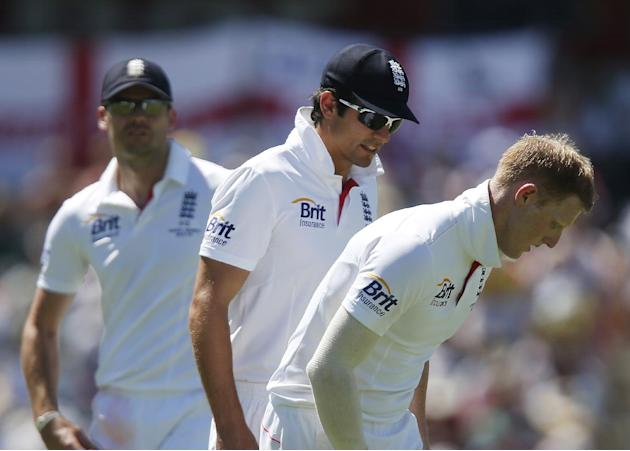 England's Ben Stokes, right, marks his bowling crease watched by teammate Alastair Cook, center, on the first day of their Ashes cricket test match against Australia in Perth, Australia, Friday, D