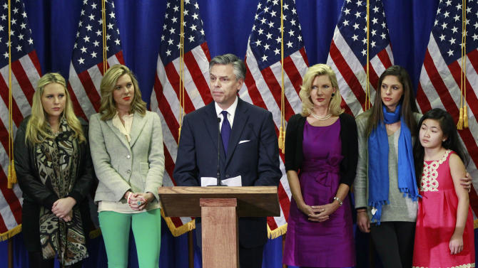 Republican presidential candidate, former Utah Gov. Jon Huntsman, accompanied by his family, announces he is ending his campaign, Monday, Jan. 16, 2012,  in Myrtle Beach, S.C. From left are, daughters Elizabeth, Mary Anne, Huntsman, his wife Mary Kaye, and daughters, Abby, Gracie. (AP Photo/Charles Dharapak)