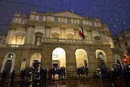Guests arrive on opening night at La Scala opera house in Milan. On Friday it celebrated the start of its 2012/2013 season with Richard Wagner&#39;s &quot;Lohengrin&quot; -- a disputed choice ahead of the bicentenaries of the famous German composer and his Italian rival Giuseppe Verdi
