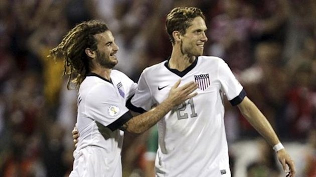 United States players Kyle Beckerman (L) and Clarence Goodson celebrate their victory over Mexico