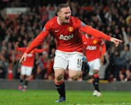 Manchester United's English forward Wayne Rooney celebrates after scoring against Fulham during an English Premier League football match at Old Trafford in Manchester. United won 1-0