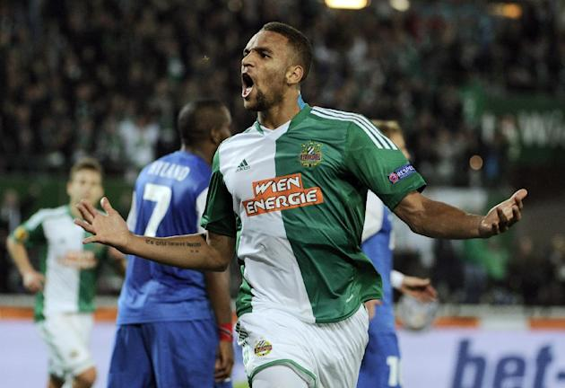 Rapid's Terrence Boyd celebrates after scoring during the Europa League group G soccer match between SK Rapid Vienna  and Belgian club  KRC Genk, in  Vienna, Austria, Thursday, Nov. 7, 2013