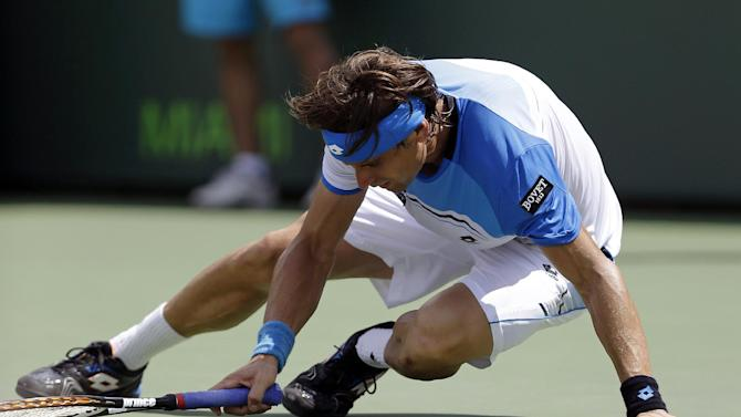 David Ferrer, of Spain, falls on the court during a match against Andy Murray, of Britain, at the final of the Sony Open tennis tournament, Sunday, March 31, 2013, in Key Biscayne, Fla. Murray won 2-6, 6-4, 7-6 (1). (AP Photo/Wilfredo Lee)
