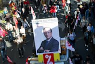 <p>Demonstrators hold a placard with a photograph of French President Francois Hollande during a protest in Paris last month against against austerity measures and the European budgetary treaty. EU leaders gather in Brussels for a summit Thursday on strengthening the bloc's shaky foundations as Spain appears set finally to ask for financial aid, easing a key eurozone pressure point</p>