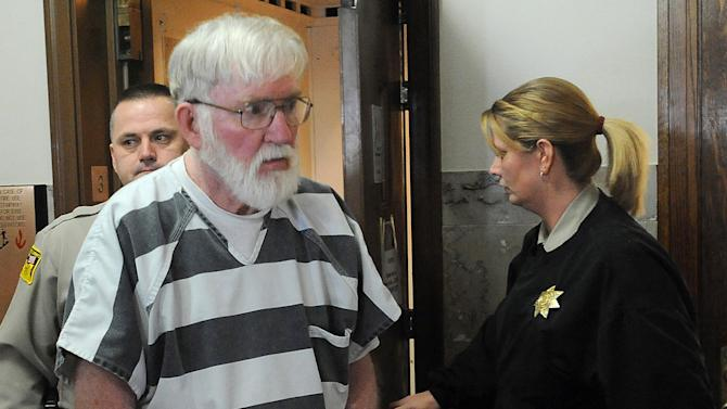 FILE - In this Feb. 2, 2012, file photo Carl Ericsson is escorted into court in Madison, S.D.  The 73-year-old South Dakota man accused of fatally shooting his long-ago classmate will plead guilty but mentally ill to a second-degree murder charge, his attorney said Tuesday, May 1, 2012.  (AP Photo/Argus Leader, Elisha Page, File)