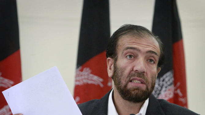 Afghan Election Commission Chairman Fazel Ahmad Manawi reads off names of the new parliamentarians during a press conference in Kabul, Afghanistan on Sunday, Aug. 21, 2011. The election officials said Sunday that nine parliamentarians should be removed from their posts because of election fraud allegations, an attempt to put an end to a nearly year-long state of limbo in the legislature. (AP Photo/Musadeq Sadeq)