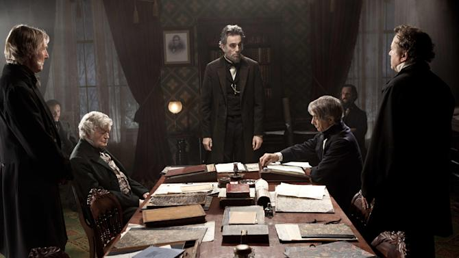 "FILE - This undated publicity photo released by DreamWorks and Twentieth Century Fox, shows Daniel Day-Lewis, center rear, as Abraham Lincoln, in a scene from the film, ""Lincoln.""  On Monday, Dec. 3, 2012, The New York Film Critics Circle announced their picks for best film and the top performances of the year, one of the first major awards in the drumbeat ahead of the Academy Awards. Day-Lewis won best actor for his performance as the 16th president. It's the actor's fifth award from the New York Film Critics Circle.  (AP Photo/DreamWorks, Twentieth Century Fox, David James, File)"