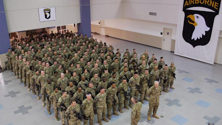 Maj. Gen. James McConville, front left, speaks to troops from the 101st Airborne Division on Tuesday, Feb. 19, 2013, as they prepare to leave Fort Campbell, Ky., for a yearlong deployment to Afghanistan. McConville says the division has to be agile and adaptive as they set the stage for the 2014 withdrawal of U.S. combat forces. (AP Photo/Kristin M. Hall)