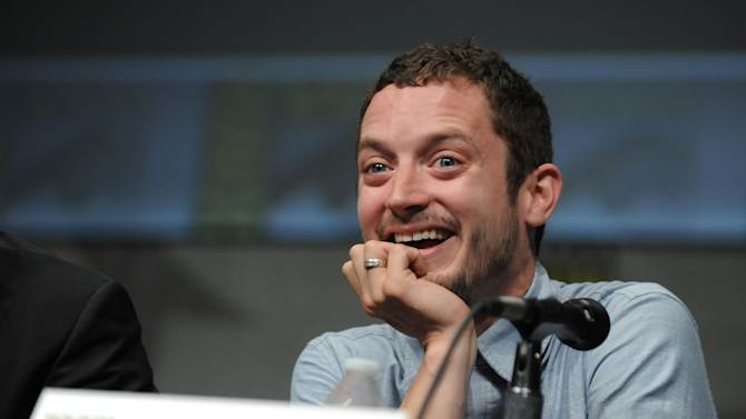 """Elijah Wood speaks at the """"The Hobbit: An Unexpected Journey"""" panel 2012 Comic Con on Saturday, July 14, 2012 in San Diego, Calif. (Photo by Jordan Strauss/Invision/AP)"""